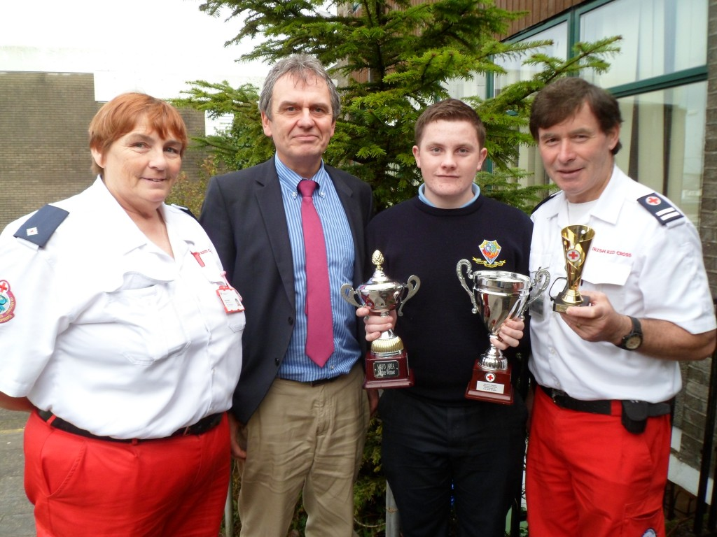 Ronan Ganon Cloonfad, a pupil from Dunmore Community School won three awards in the Red Cross  First Aid Competitions in the Novice section. In June he won the Mayo Area Novice Individual prize and in October he won first prize in the Western Region Novice Individual competition and went on to win second prize in the National All Ireland competition in the Individual novice section. Pictured with Ronan are are Rose Ward Area Training Officer and Kieran Conolly Unit Officer of the Irish Red Cross Claremorris Branch where Ronan is a member along with Principal of Dunmore Community School Gay McManus.