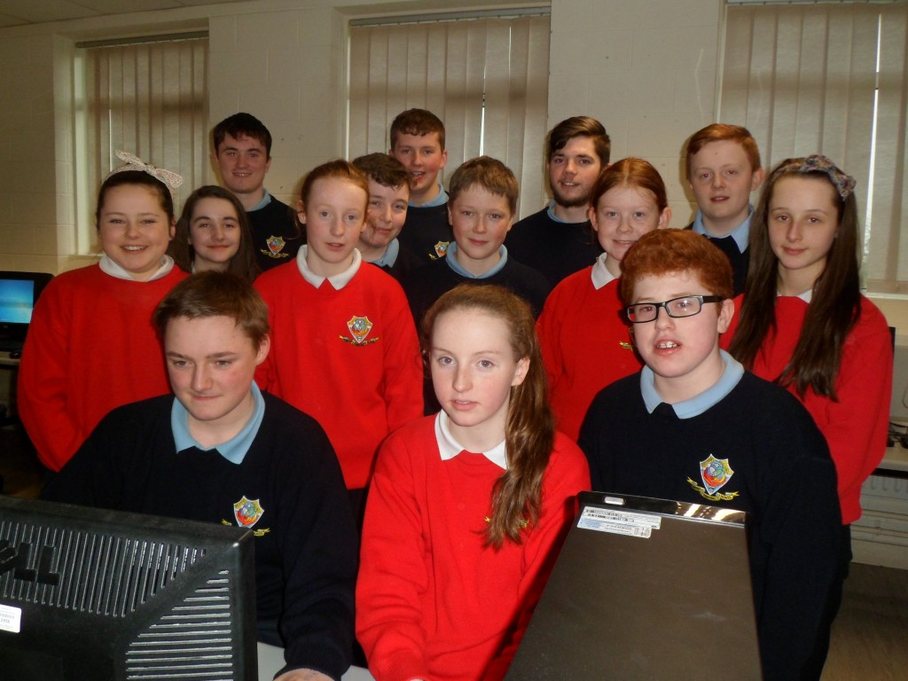 Google Call to Coding Competition . A number of students took part in computer coding classes taught by student mentors. Pictured are the students involved with their mentors. Two students Conal Walshe (front left) and Emma Kelly (middle) were among the top students in the country in the coding competition.