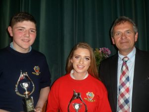 Principal Gay McManus pictured with Sports Award winners Piercr Kirrane and Bonnie McGinley