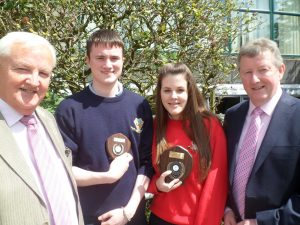 Shane Flanagan received an award for four years full attendance and Emma Brady for five five years full attendance. They are pictured with Billy Hannon Chairman BOM and Sean Canney Minister of State
