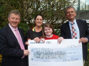 Transition Year student Orna Burke is presented with her cheque which was raised as part of her Transition Year Mini Company. She is pictured with Sean Canney, Mininster of State, teacher, Mary Grehan and Principal, Gay McManus.